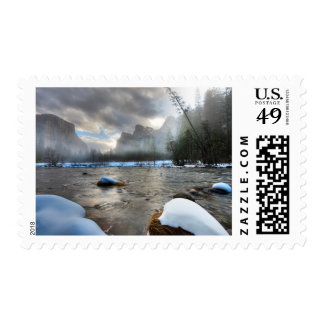 Snow covered Merced River. El Capitan background Stamps