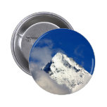Snow covered mountain tip pinback button