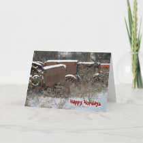 Snow-covered tractors holiday card