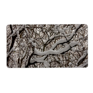 Snow covered tree branches label