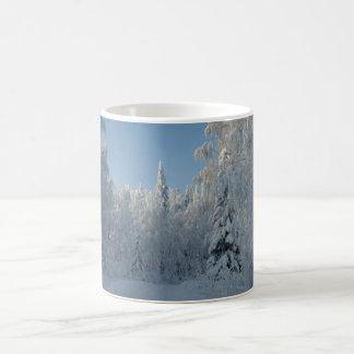 Snow covered trees coffee mug
