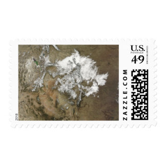 Snow covers the Rocky Mountains in United State Postage