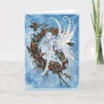 "Snow fairy Yuletide greeting card<br><div class=""desc"">Send your Yuletide greetings with this beautiful snow fairy perched on a holly wreath.</div>"