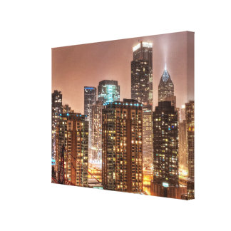 Snow falls over skyline at evening in Chicago Gallery Wrap Canvas