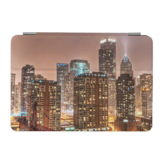 Snow falls over skyline at evening in Chicago iPad Mini Cover
