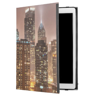 Snow falls over skyline at evening in Chicago iPad Pro Case
