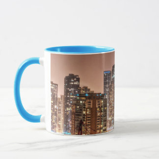 Snow falls over skyline at evening in Chicago Mug