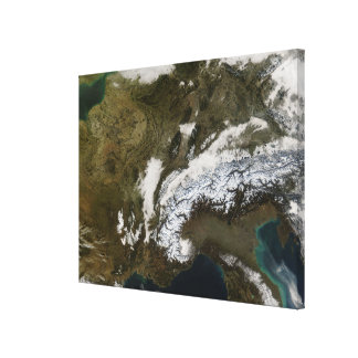 Snow, fog, and low clouds in western Europe Canvas Print