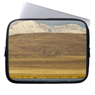 Snow geese during spring migration laptop computer sleeve