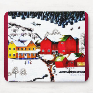 snow land with houses and trees around mouse pad