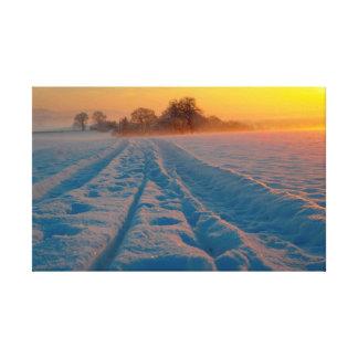 Snow landscape with sunrise, dirt road, canvas prints