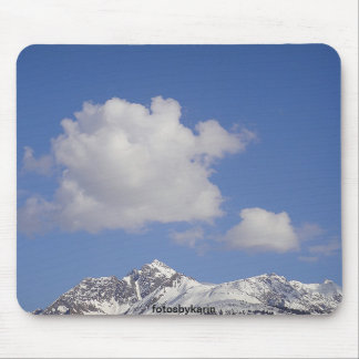 Snow mountain with clouds before blue sky, mouse pad