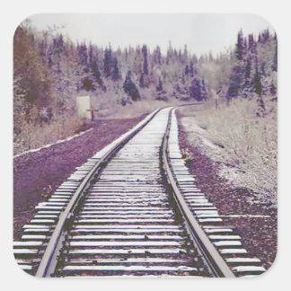 Snow on the tracks square sticker
