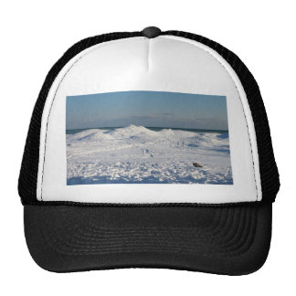 Snow piles on I winters day Trucker Hat