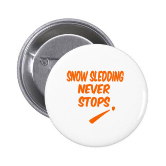 Snow Sledding Never Stops Pinback Button
