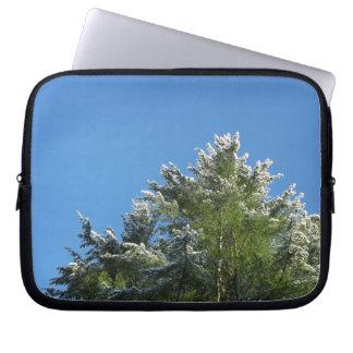 Snow-tipped Pine Tree on Blue Sky Computer Sleeve