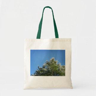 Snow-tipped Pine Tree on Blue Sky Tote Bag