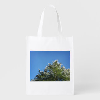 Snow-tipped Pine Tree on Blue Sky Reusable Grocery Bags