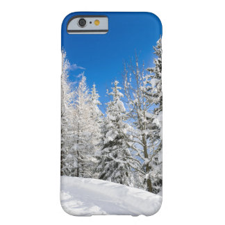 Snow trees under a clear blue sky phone case
