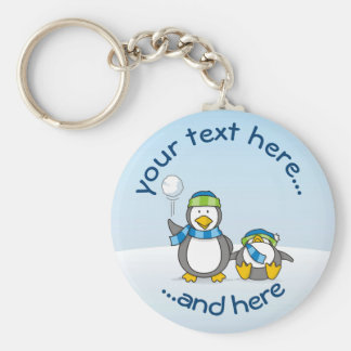 Snowballing penguins keychain