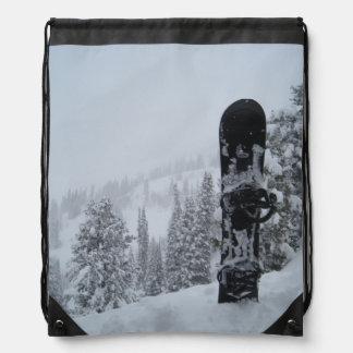 Snowboard en nieve mochilas