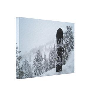 Snowboard In Snow Canvas Print
