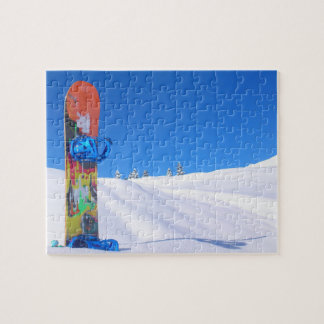 Snowboard in Snow on Bluebird Day Jigsaw Puzzle