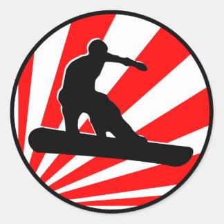 snowboard. rayos rojos pegatina redonda