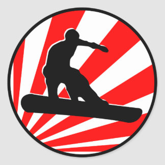 snowboard. red rays. classic round sticker