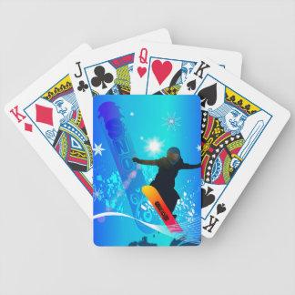 Snowboard, snowboarder con el tablero baraja de cartas
