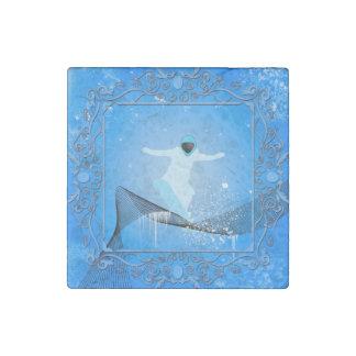 Snowboarder con los copos de nieve imán de piedra