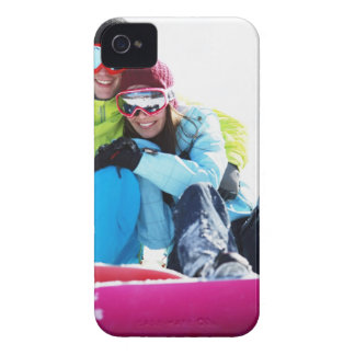 Snowboarder couple sitting on snow iPhone 4 cover