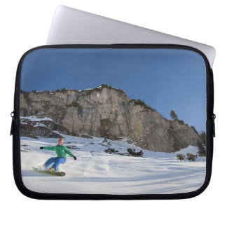 Snowboarder free riding laptop sleeves