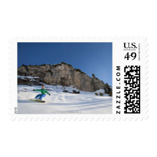 Snowboarder free riding postage stamps
