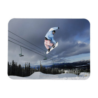 Snowboarder jumping in mid-air doing a backside rectangular photo magnet