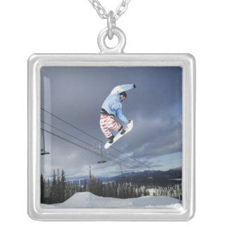 Snowboarder jumping in mid-air doing a backside silver plated necklace