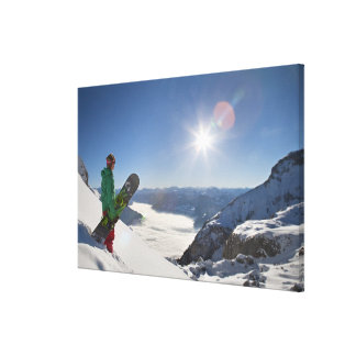 Snowboarder looking from mountain top canvas print