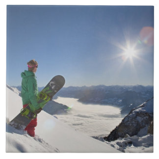 Snowboarder looking from mountain top ceramic tile