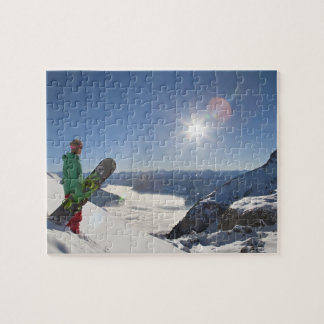 Snowboarder looking from mountain top jigsaw puzzle