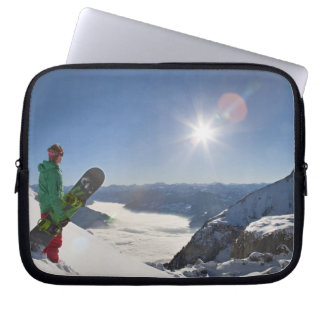 Snowboarder looking from mountain top laptop sleeve