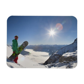 Snowboarder looking from mountain top rectangular photo magnet