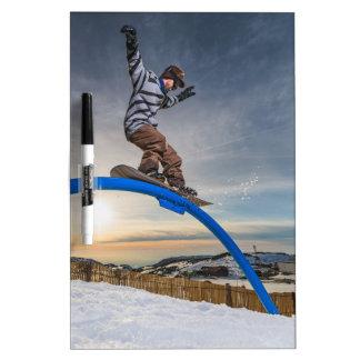 Snowboarder sliding on a rail Dry-Erase board