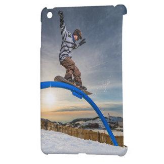 Snowboarder sliding on a rail iPad mini covers