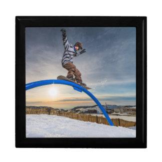 Snowboarder sliding on a rail keepsake box