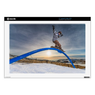 Snowboarder sliding on a rail laptop decals