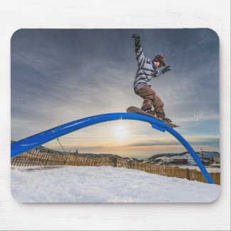 Snowboarder sliding on a rail mouse pad