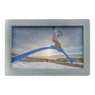 Snowboarder sliding on a rail rectangular belt buckle