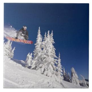 Snowboarding action at Whitefish Mountain Resort Ceramic Tile