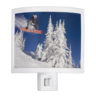 Snowboarding action at Whitefish Mountain Resort Night Light