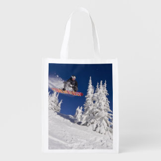 Snowboarding action at Whitefish Mountain Resort Reusable Grocery Bag
